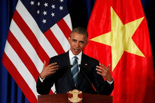 U.S. President Barack Obama attends a press conference with Vietnam's President Tran Dai Quang (not pictured) at the Presidential Palace Compound in Hanoi, Vietnam May 23, 2016. REUTERS/Carlos Barria