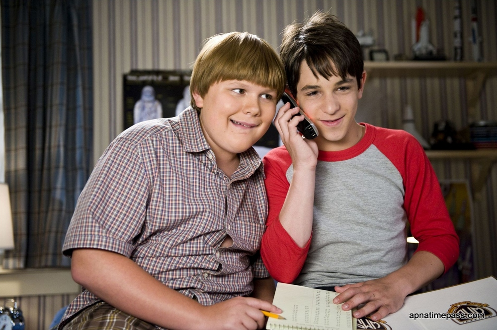 DF-07372 - Greg (Zachary Gordon) enjoys a phone conversation with his romantic crush, as Rowley (Robert Capron) listens in.