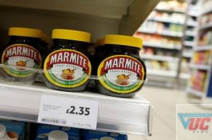Jars of savoury spread 'Marmite' which is owned by the Anglo-Dutch multinational Unilever, on sale in a branch of Tesco in central London, Thursday, Oct. 13,2016. Britain's biggest supermarket chain, Tesco, has pulled cherished products such as Marmite spread and Ben & Jerry's ice cream from its website amid a dispute with consumer goods giant Unilever. (AP Photo/Alastair Grant)